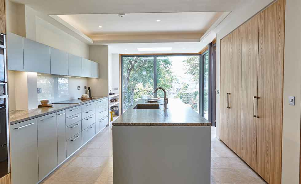 Designed by CaSA Architects, this terraced extension houses a new kitchen diner
