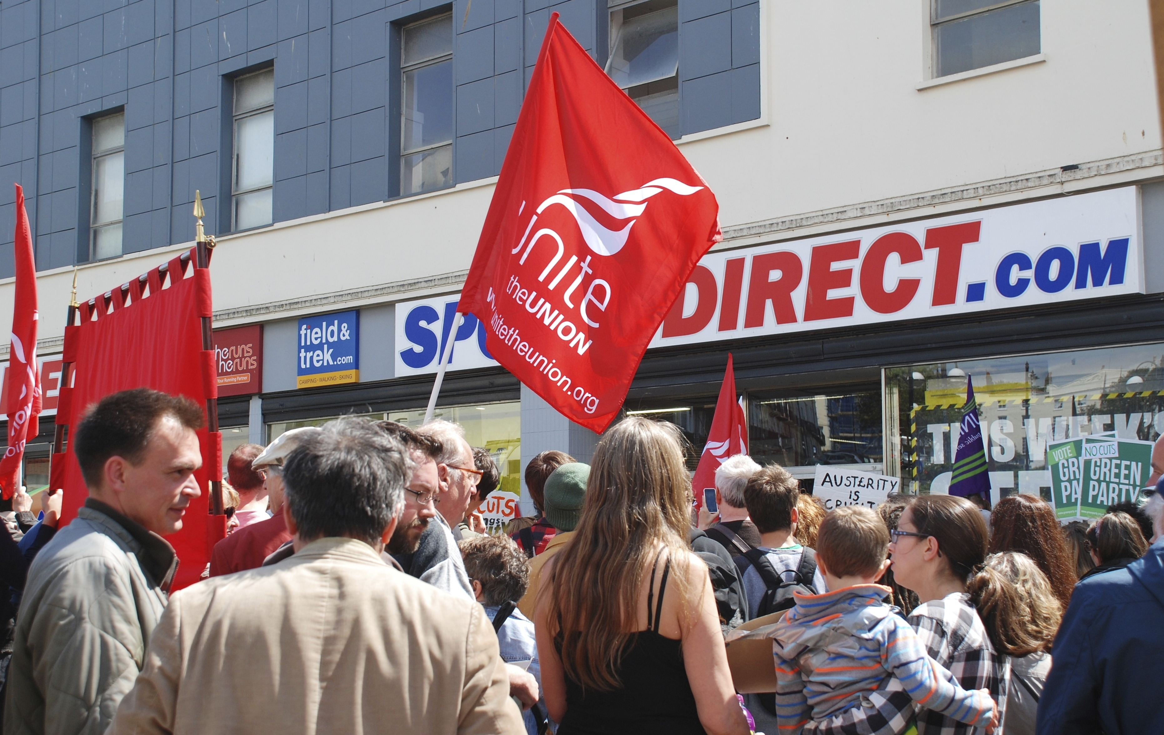 People protest against zero hour employment contracts outside a branch of Sports Direct in Hastings.