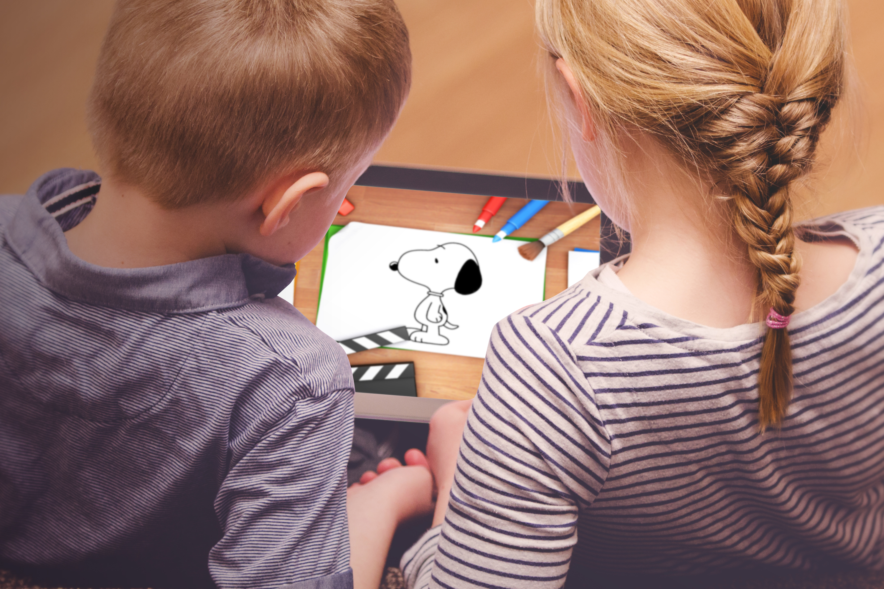 Siblings Playing on Tablet PC