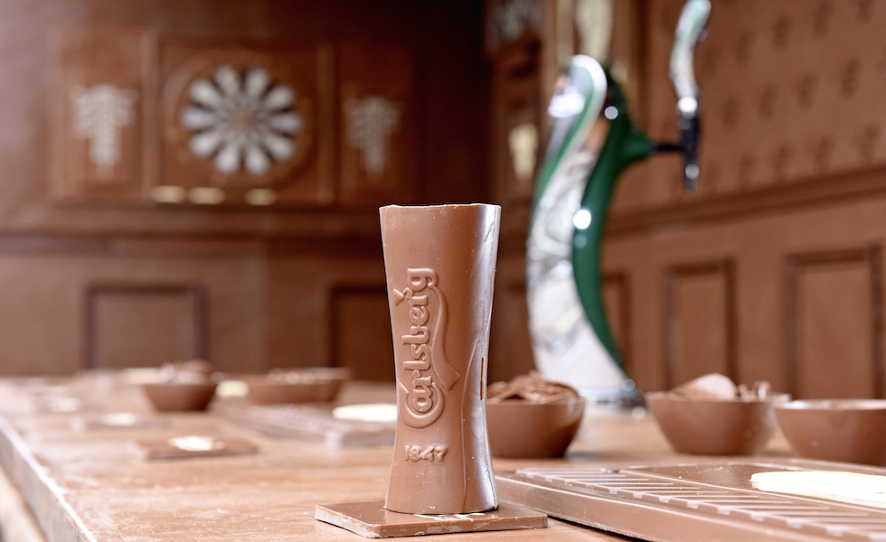 If Carlsberg did chocolate bars...  Pictured: The interior of the bar included hand crafted chocolate glasses, pictures and a dartboard, all made out of chocolate.