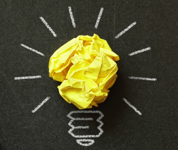 Inspiration concept crumpled paper light bulb metaphor for choosing the best idea