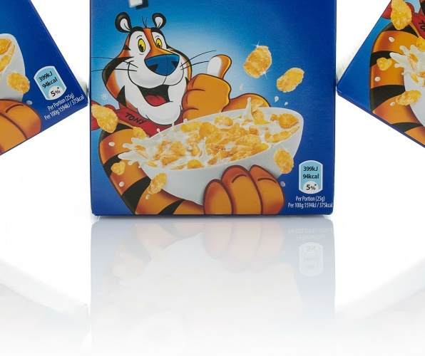 SWINDON, UK - MAY 3, 2015: Three Packets of Kelloggs Frosties on a white background