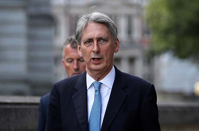 LONDON, ENGLAND - JULY 12: Philip Hammond, Secretary of State for Foreign and Commonwealth Affairs, arrives for a cabinet meeting at the back of Downing Street on July 12, 2016 in London, England. David Cameron will step aside tomorrow (Wednesday) after his final Prime Minister's Questions allowing current Home Secretary Theresa May to move into 10 Downing Street. She was selected unopposed by Conservative MPs to be their new leader. (Photo by Dan Kitwood/Getty Images)