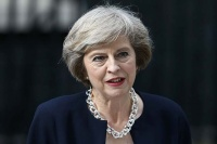 Britain's new Prime Minister Theresa May speaks outside 10 Downing Street in central London on July 13, 2016 on the day she takes office following the formal resignation of David Cameron. Theresa May took office as Britain's second female prime minister on July 13 charged with guiding the UK out of the European Union after a deeply devisive referendum campaign ended with Britain voting to leave and David Cameron resigning. / AFP / JUSTIN TALLIS (Photo credit should read JUSTIN TALLIS/AFP/Getty Images)