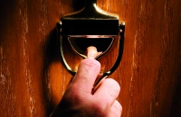 Door knocker with man's hand. Place your text on a knocker plate.