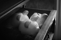 File image of Three piggy banks tucked in a drawer