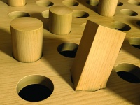 A square peg forced into a round hole.