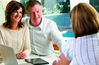 Happy mature Couple in Meeting With Advisor at home