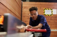 Carpenter Using Plane In Woodworking Woodshop for article on Workplace pensions