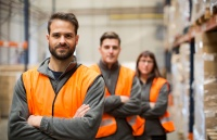 Warehouse workers portrait in work overalls. Workplace pensions article