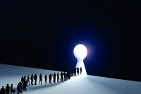 People in front of a bright keyhole opening
