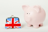 A pink piggy bank with a Union Jack