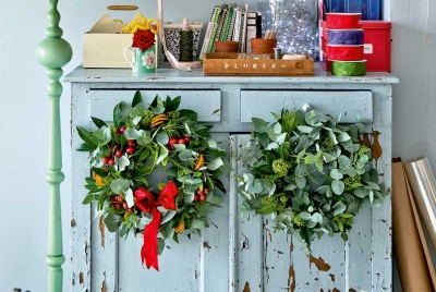 Christmas wreaths hanging on a cupboard
