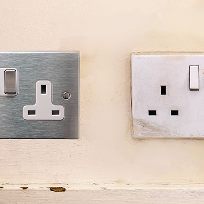 A mix of different sockets and switches suggest that a partial rewire has taken place