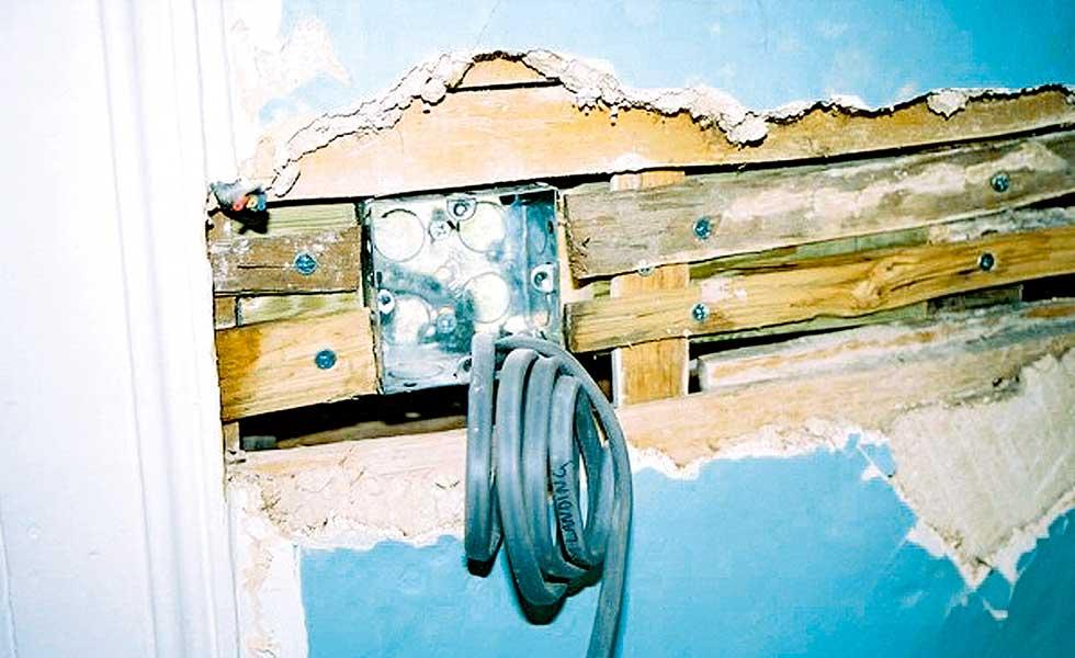 Avoid cutting through laths under plaster