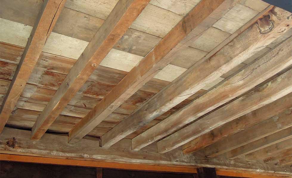 wooden floorboards joists supporting upper floor