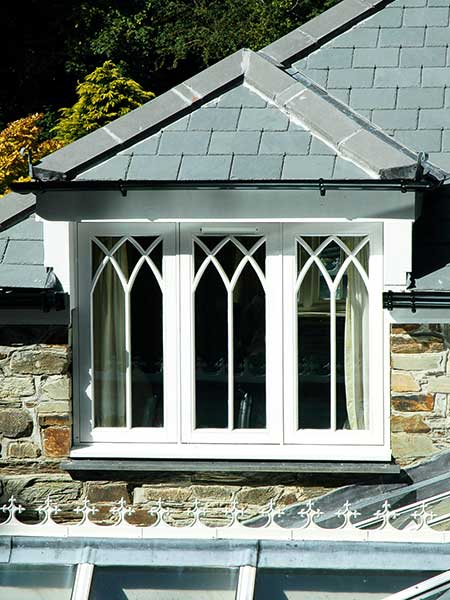 A bespoke hardwood, triple-casement window featuring Gothic timber glazing bars from Clifton Joinery