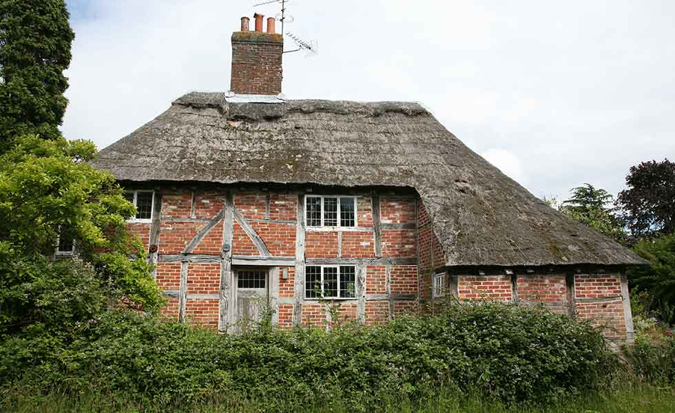 Listed run-down medieval cottage