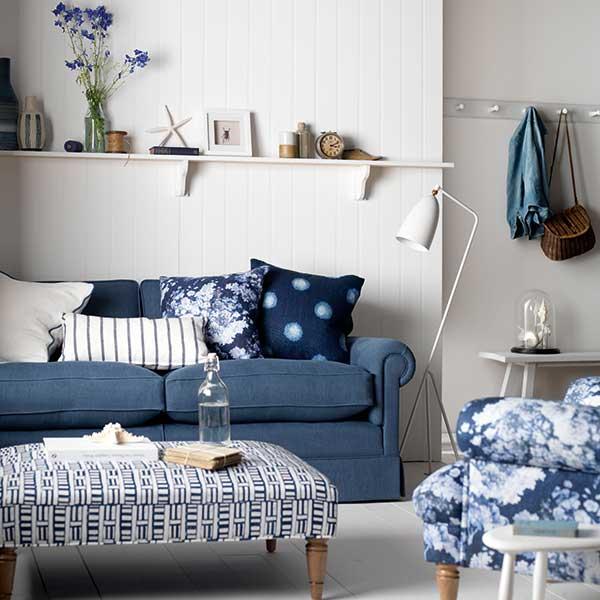 blue sofa in coastal themed living room