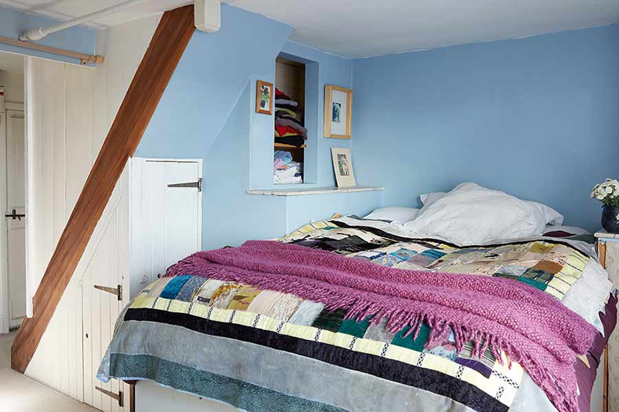 light blue small master bedroom