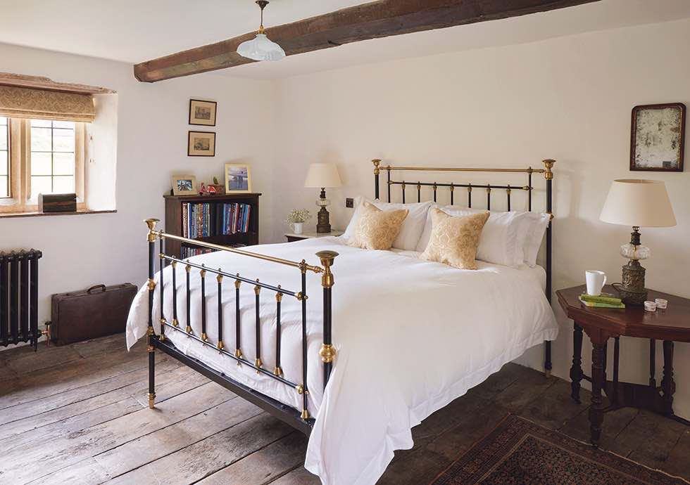master bedroom in a cotswold stone cottage