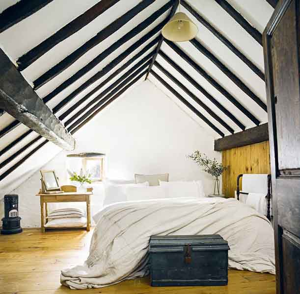 master bedroom in a thatched cottage