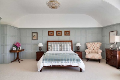 green panelled master bedroom