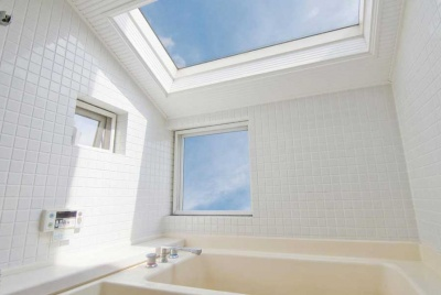 aqua steam rooms skylight bathroom white tiles blue sky