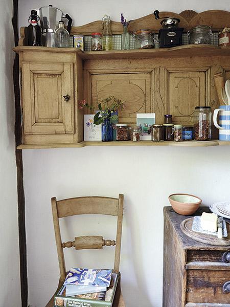 Antique shelf in kitchen in 17th-century cottage