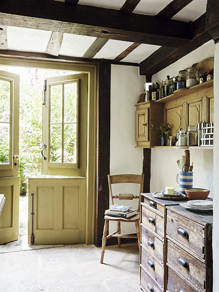 Double stable doors from the kitchen in a renovated 17th-century cottage