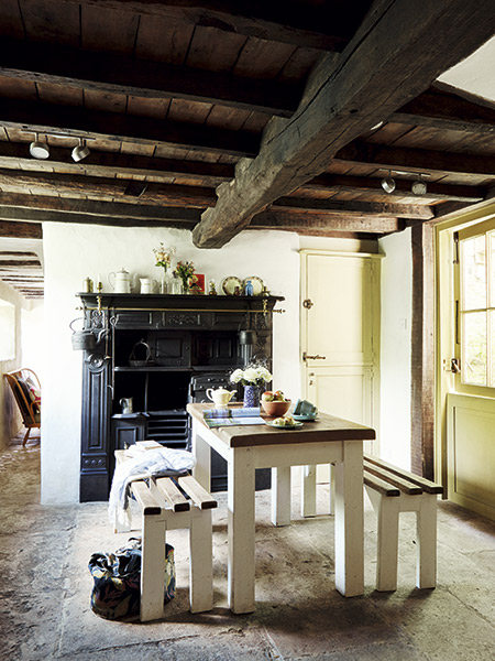 dining room in a 17th-century cottage, with restored Victorian Yorkshire range