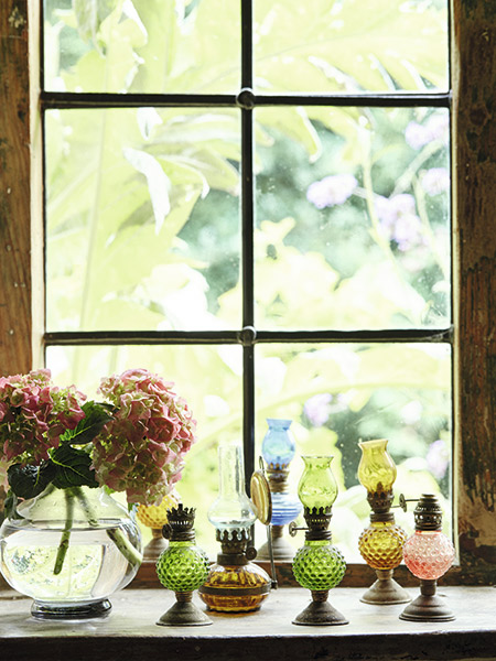 miniature oil lamps in 17th-century cottage window