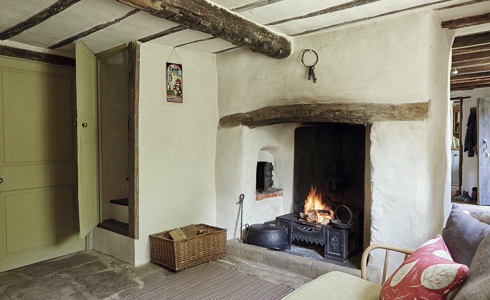 Fireplace in a 17th-century cottage, complete with its original bread oven and salt shelf