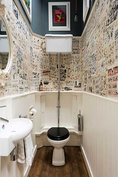 cloakroom in georgian city centre apartment with comic pages on the walls
