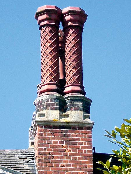 Victorian chimeny stack with tudor style pots