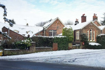19th century school conversion in the snow