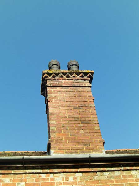 Tall and thin chimney stack with short pots