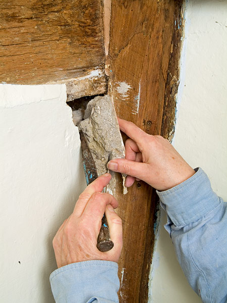 Repairing a damaged section of lime plaster
