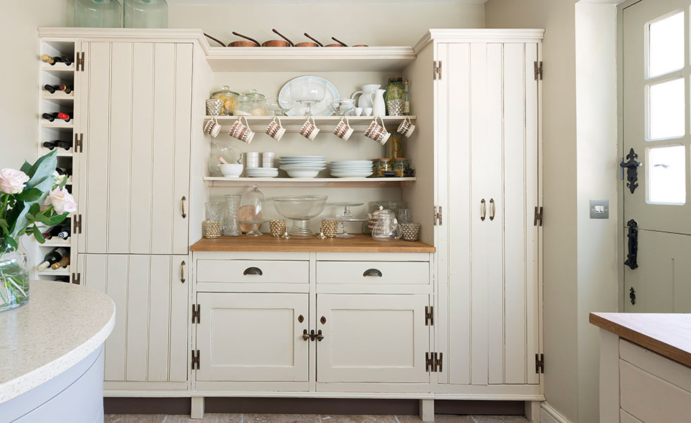 Hidden kitchen appliances in bespoke dresser