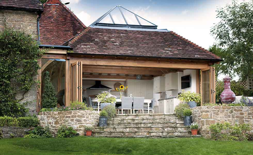 Julius Bahn oak frame orangery with bi-fold doors