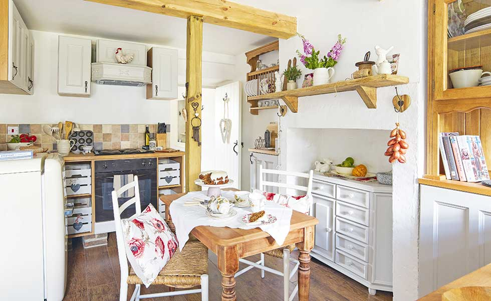 Open-plan country cottage kitchen-diner with post