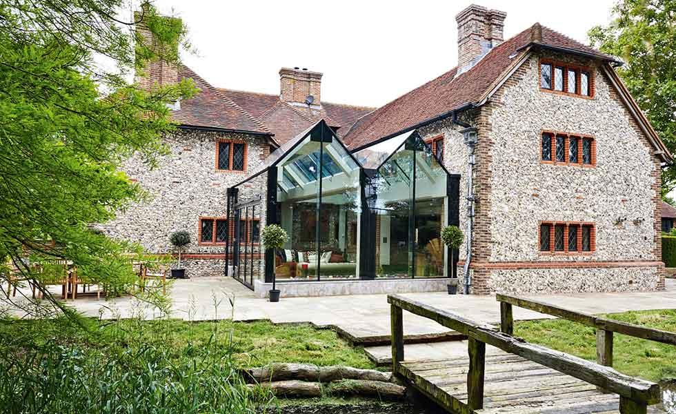 Trombe minimalist glazed modern conservatory to period home