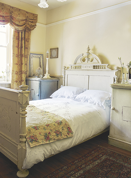 French style bedroom with antique carved bed