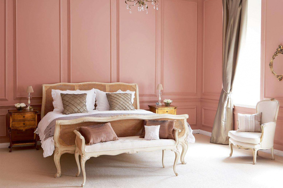 elegant panelled bedroom painted in Parlour Rose from Fired Earth