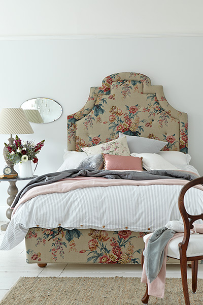 Bedroom with floral vispring bed