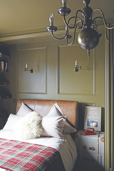 Gentleman's club bedroom with traditional panelling