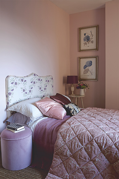 romatic bedroom in farrow and ball calamine pink with floral bed