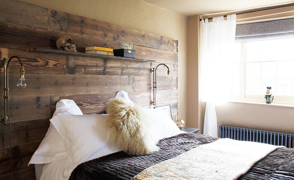 Bedroom with reclaimed timber statement headboard