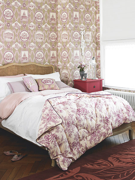 romantic french bedroom with rattan bed and ornate wallpaper