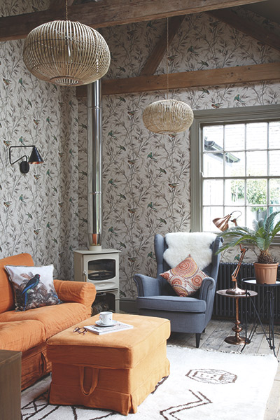 Colourful sitting room decorated in Little Greene Great Ormond street wallpaper